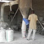 Bagging fresh mealie meal (ground corn) to make nshema.